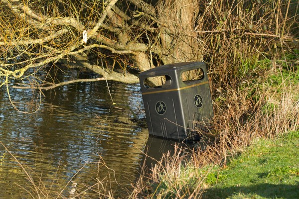 Rubbish bin discarded in Falmer Pond.