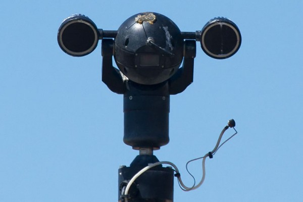 A CCTV camera posing as a weightlifter