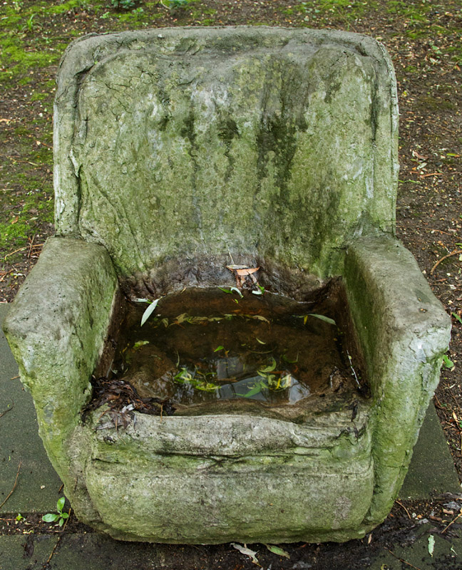 Stone Chair in the Cockcroft secret garden, University of Brighton